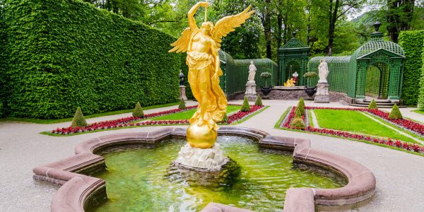 Sculpture of gold angel in the park of Linderhof Palace, Bavaria, Germany.